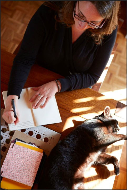 Rebecca writing with cat